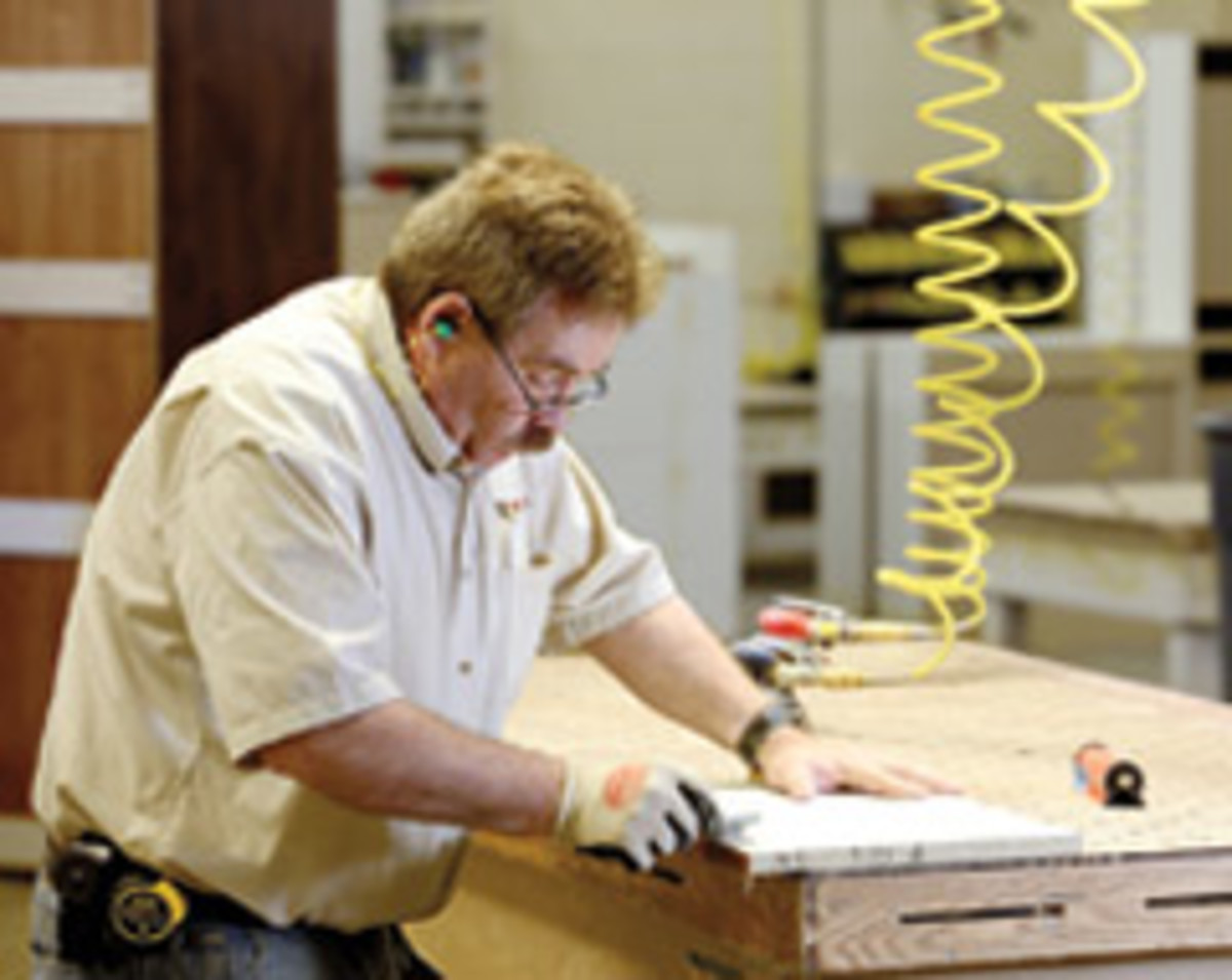 Employee Joe Kidd works in Interwest Cabinet's 21,000-sq.-ft. shop.