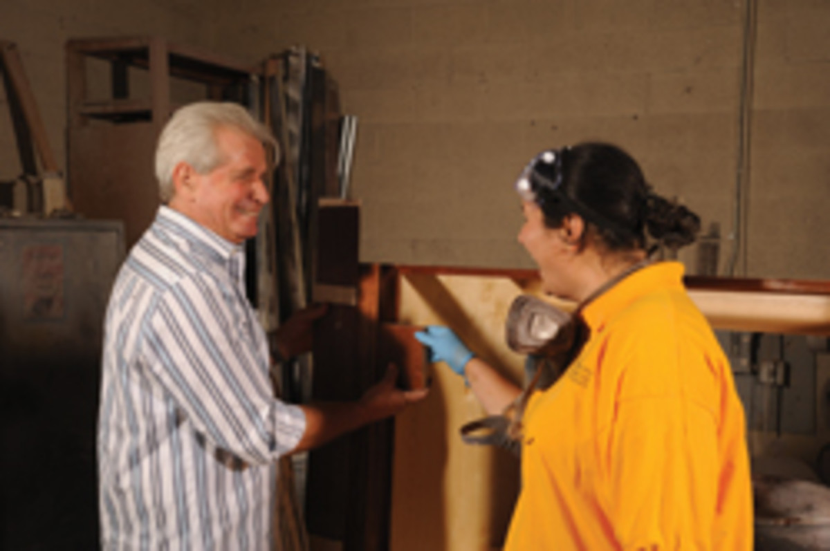 Jacob Dorenbaum (left) share a light moment with an employee at Custom Design Cabinets in Las Vegas.