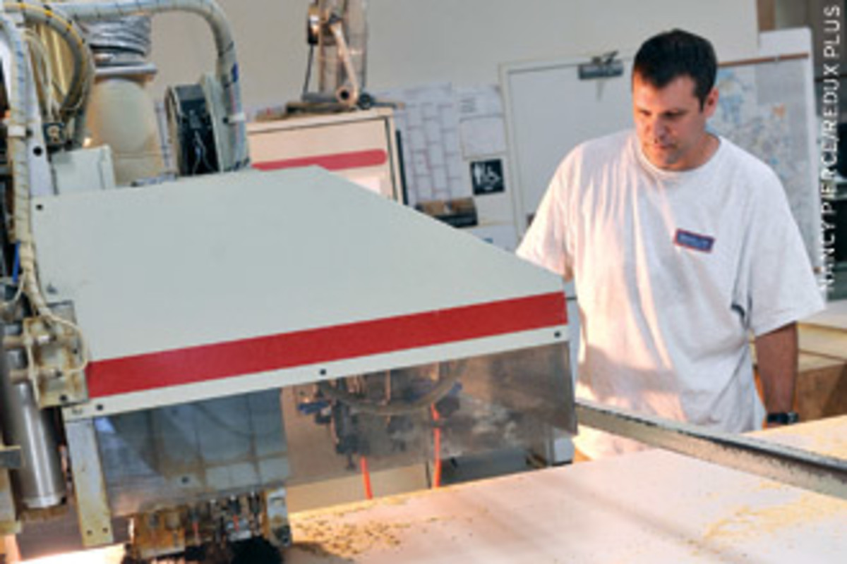 Matt Bash runs the shop's Komo CNC router.