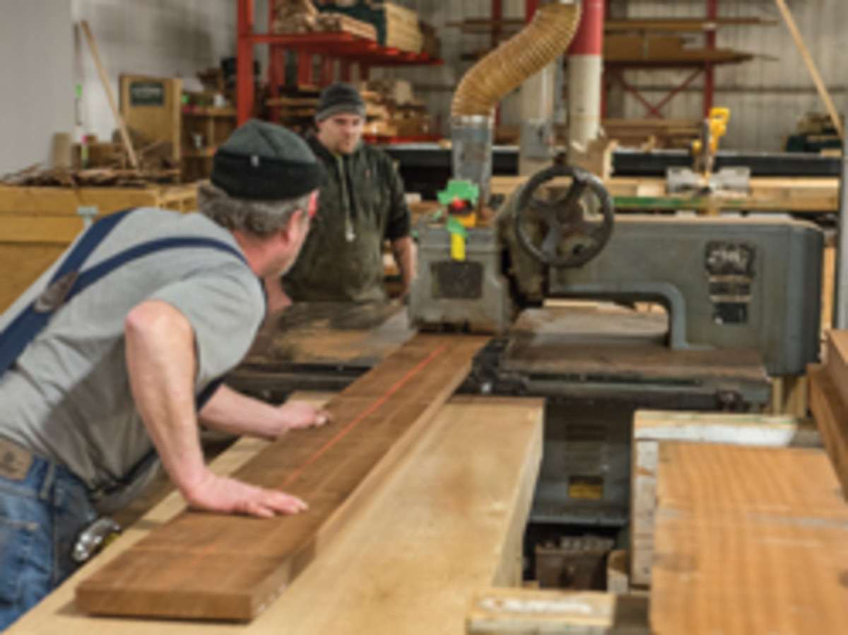 Jim Hunt and Joe Davignon run mahogany through an old Mattison straight line rip saw.