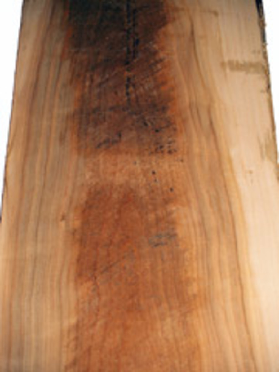 "A ""hit or miss"" board, passed through the sawmill's planer to reveal a hint of its color and grain."