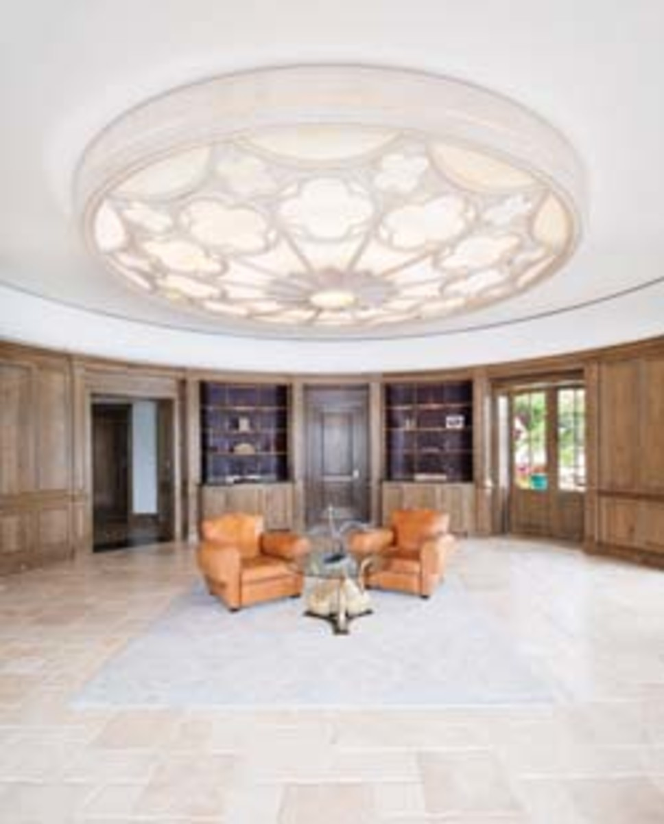 The light fixture in Palm Beach, Fla., that started a long-term and lucrative commission. Below, an elaborate entertainment center.
