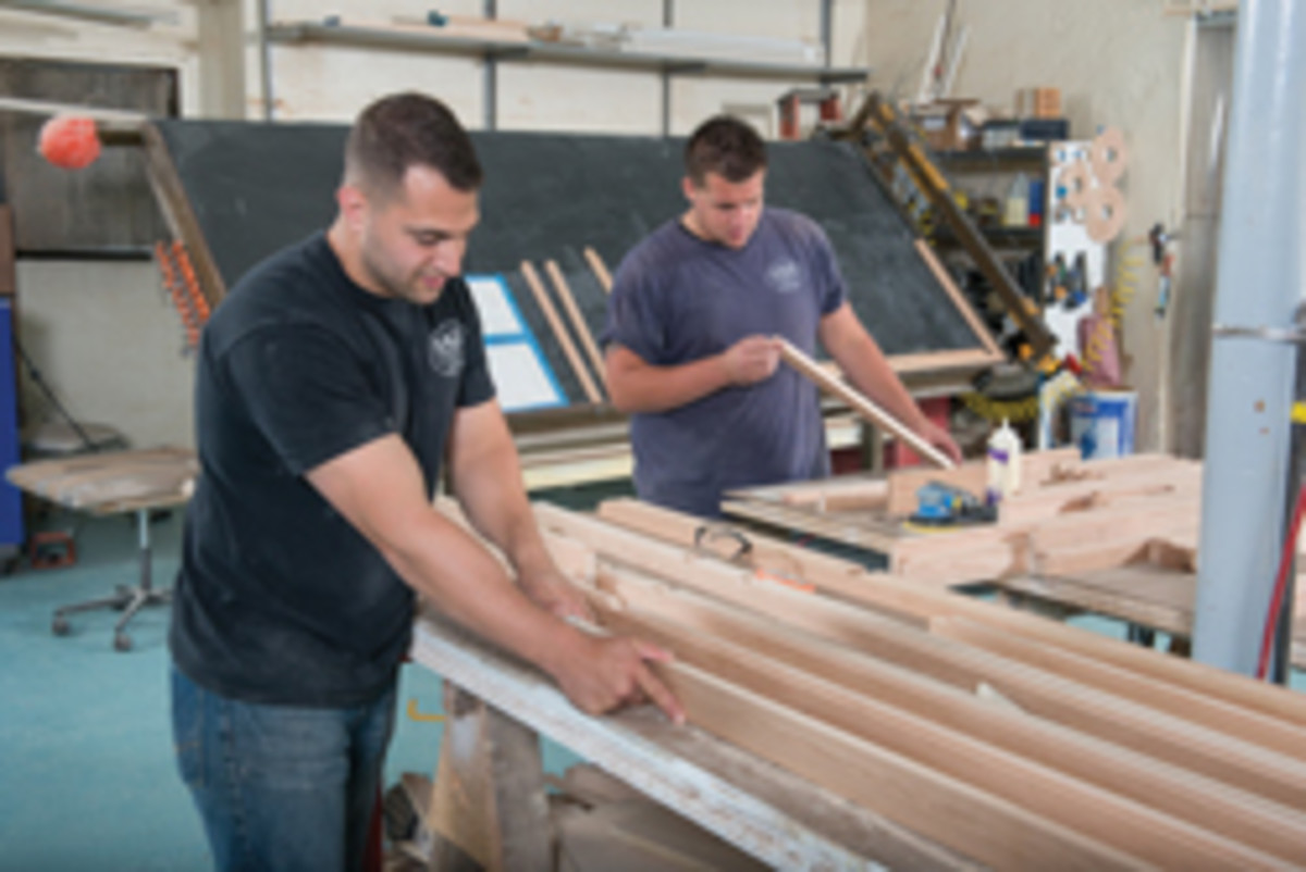 Employees Rich D'Angelo Jr. (left) and Rich Mantiglia mill some cherry.
