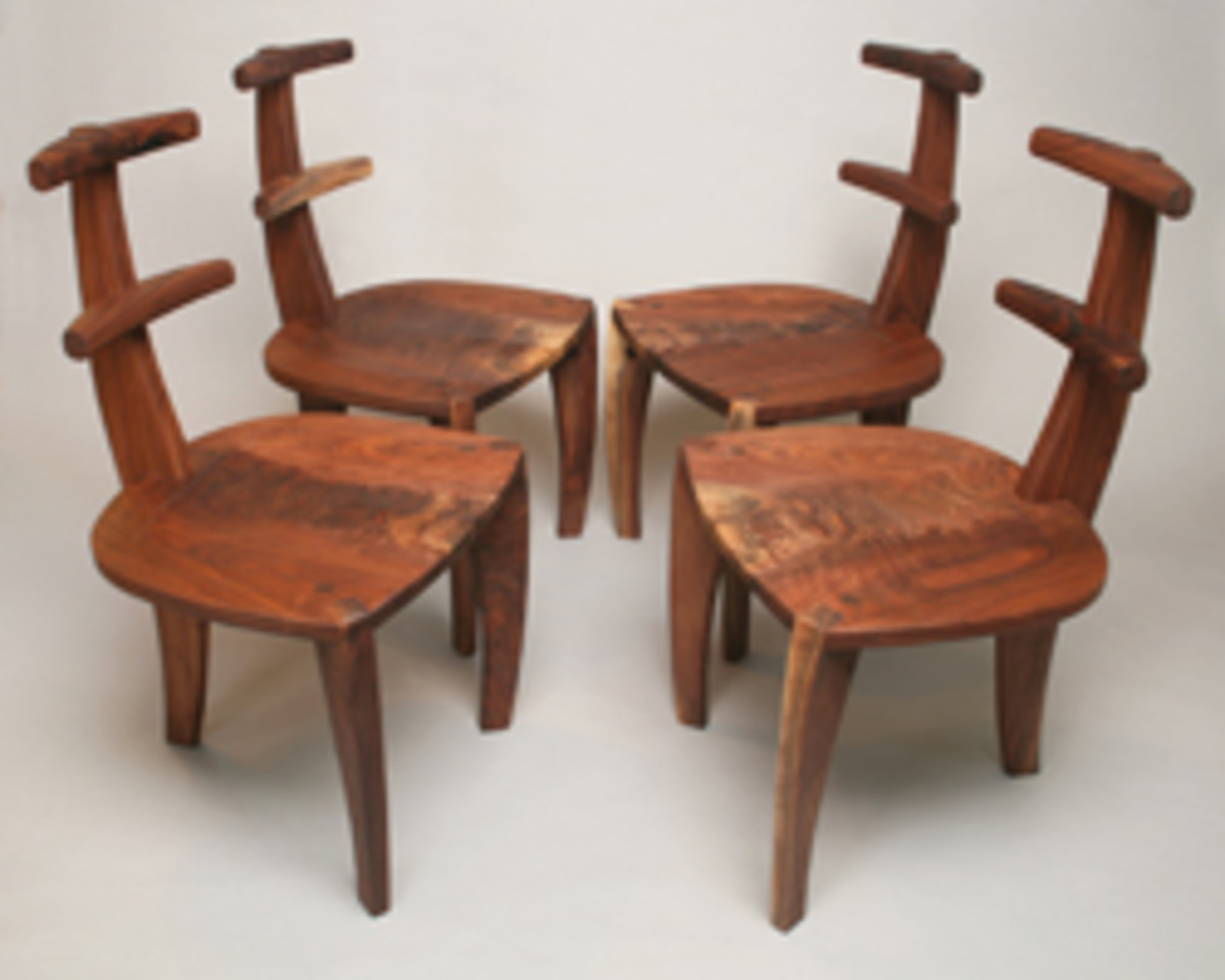Walnut chairs by Robert Andrew Black, featured at the Racine Art Museum.
