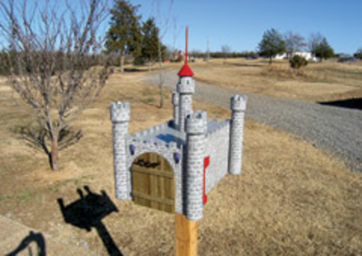 This castle mailbox, created by a woodworker in Arkansas, features a working drawbridge.