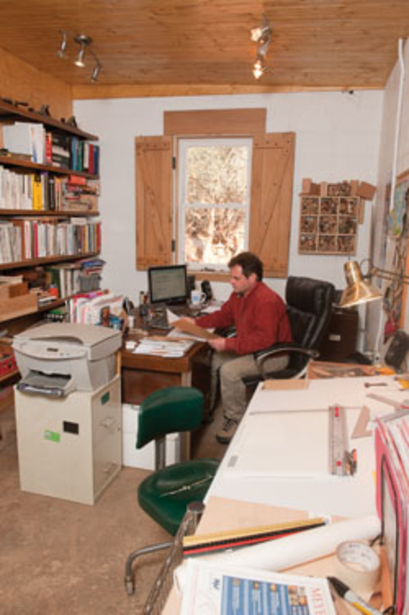Shop owner Craig Weis does the paperwork shuffle in his office at Architectural Woodcraft in Asheville, N.C.