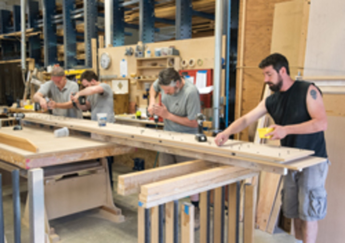 From left, VAC's Bruton Strange, Ryan Williams, Rob Vallee and Chris Shadrick team up to build a shelf.