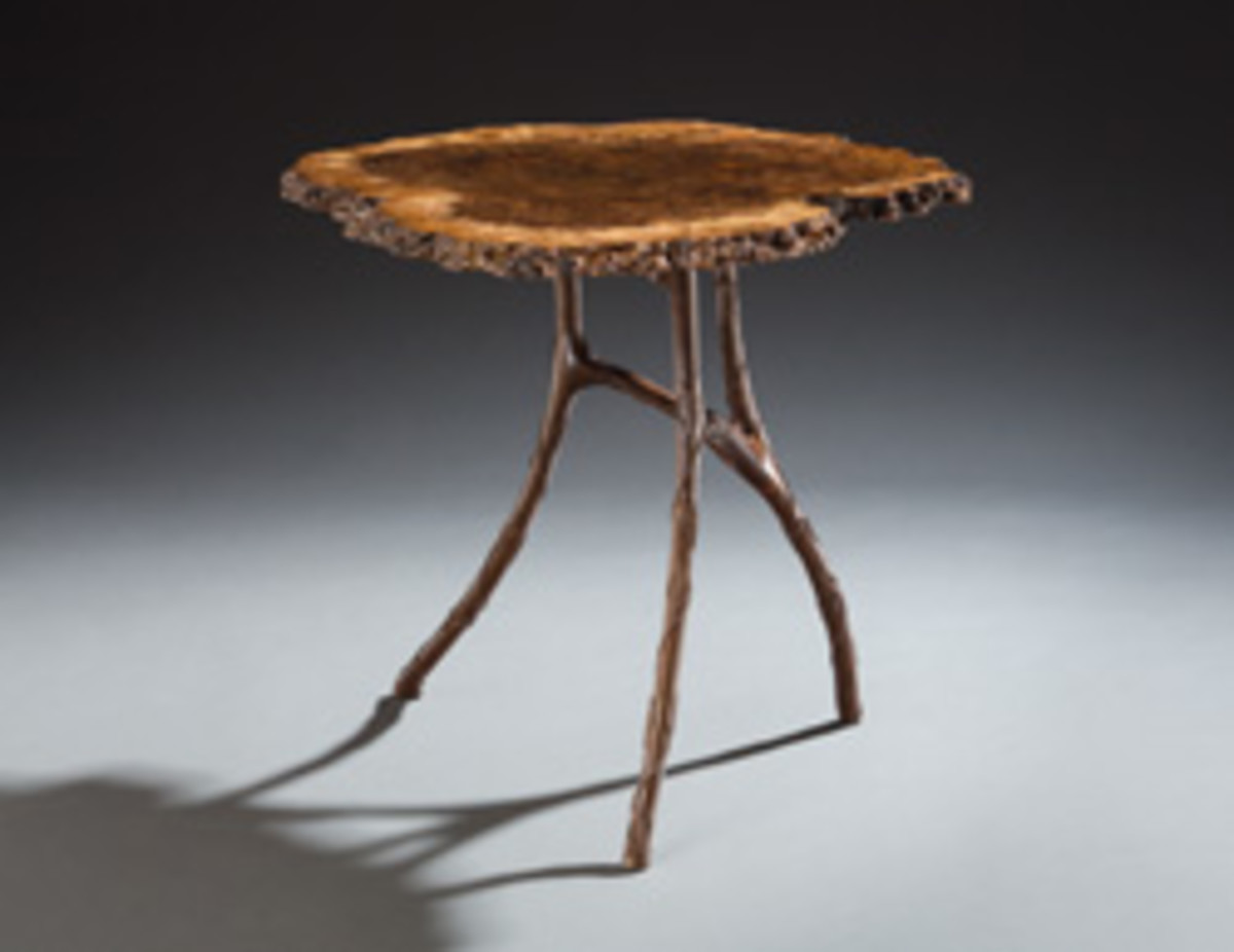 "Also in the winter show is ""Devil's Embrace,"" Greg Brown's tilt-top table with a walnut slab top."