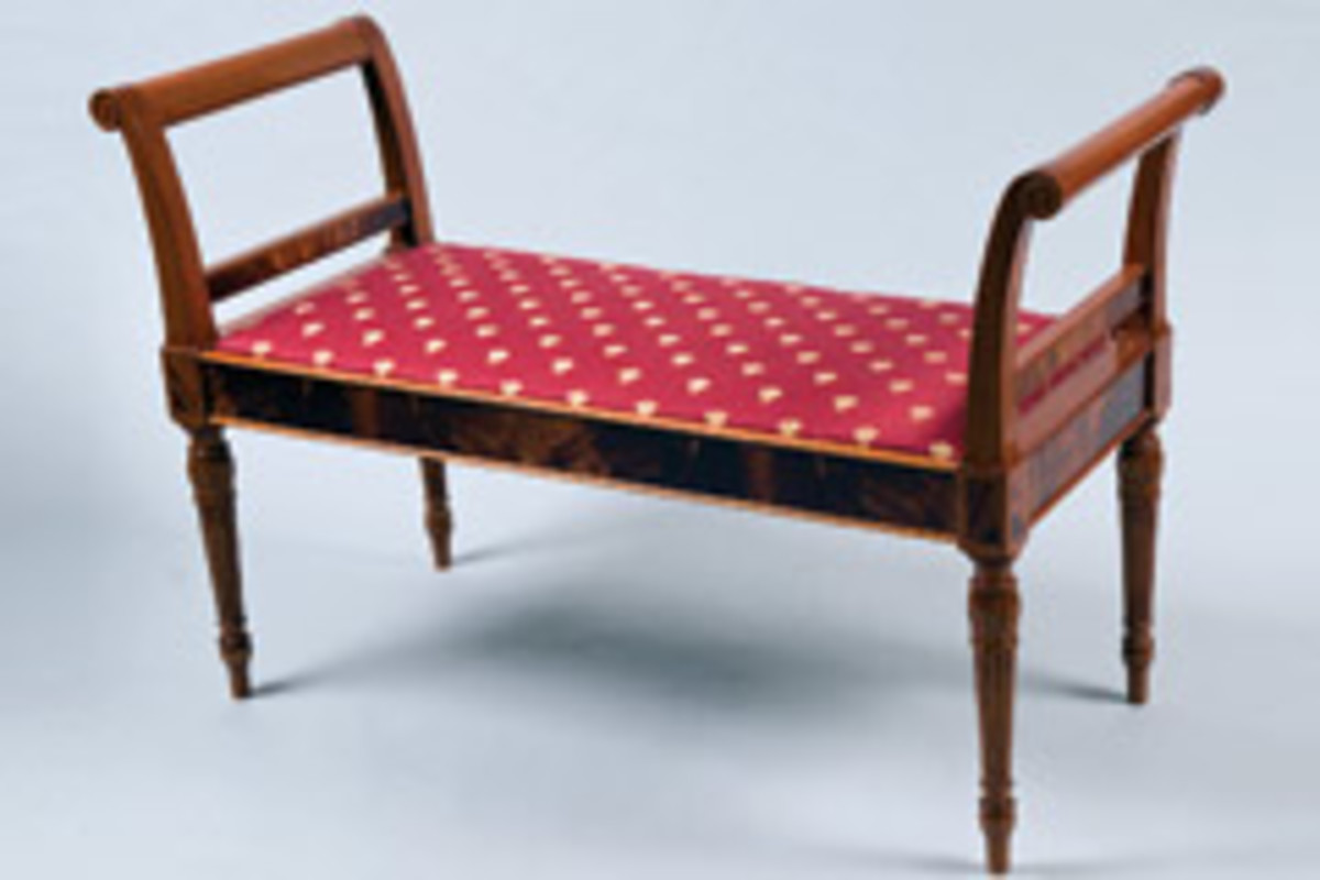 This window seat, made of mahogany and crotch mahogany, features an Old World horsehair upholstery seat.