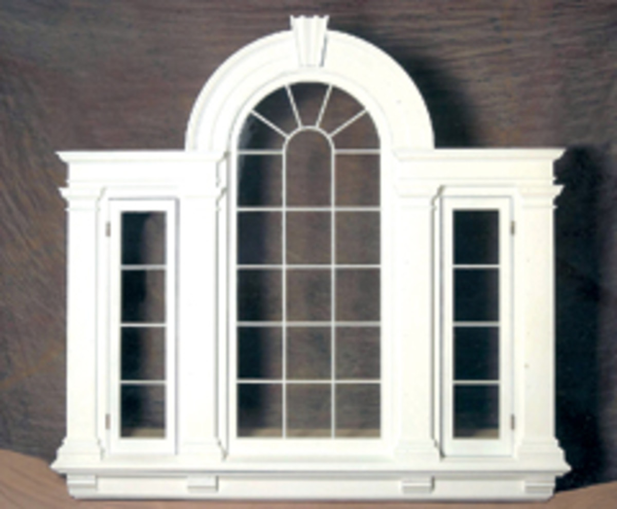 Measuring 8' high x 12' wide, this is a reproduction classical palladium window with Doric columns, keystone and attic bases.