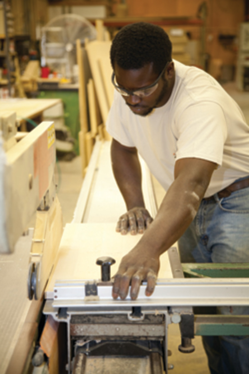 Rishawn Wilson makes a cut on the shop's Altendorf F90 slider.
