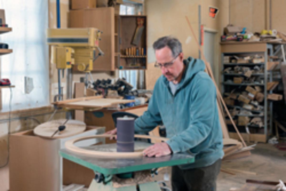 Moore at the shop's Mattison No. 131 stroke sander.