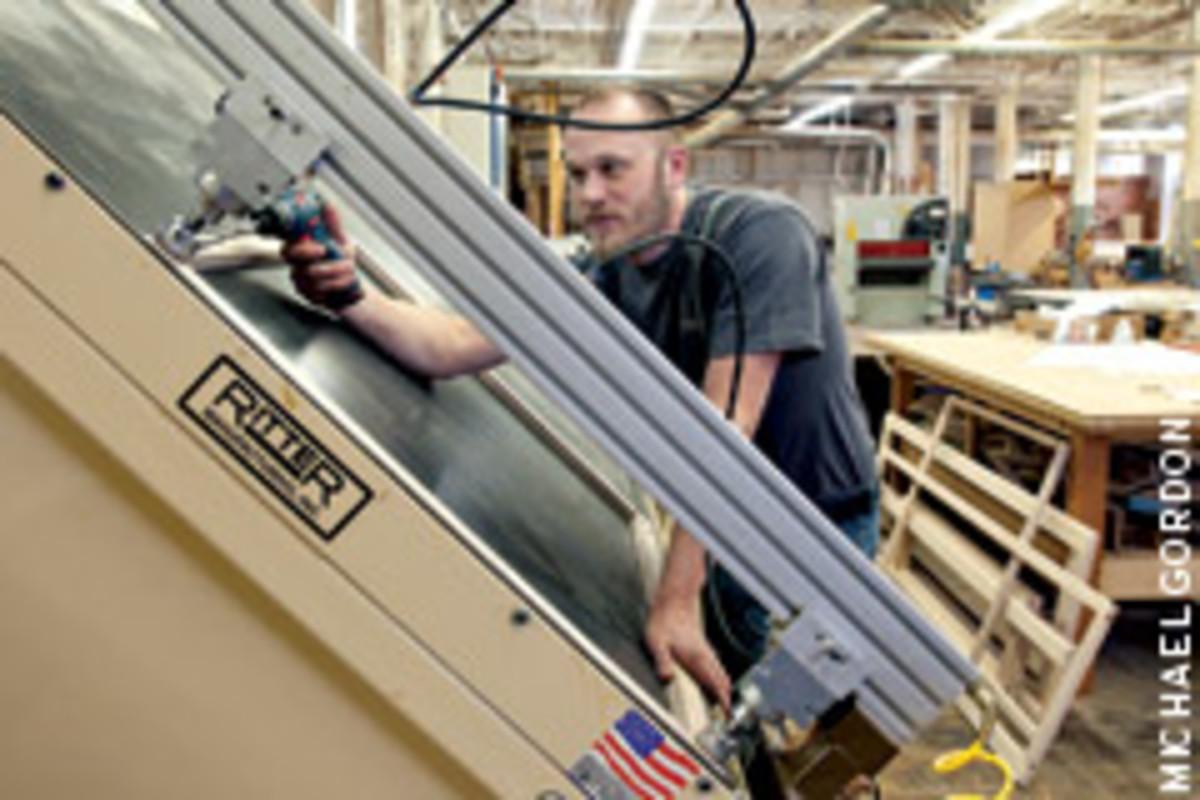 Shop manager Nate Nielsen assembles a face frame.