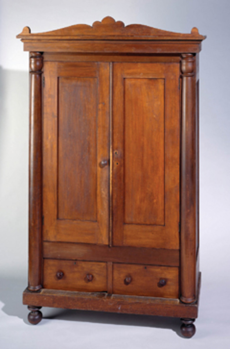 Yellow pine and a scroll interior highlight this wardrobe made by Day in 1854.