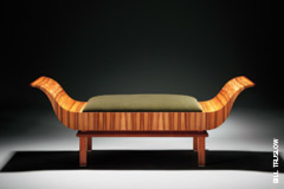 "Thom Walsh, a member of the N.H. Furniture Masters, built ""Sleigh Endings, Love Seat"" with Chilean tineo veneer, a solid mahogany base and Panaz green mohair upholstery."