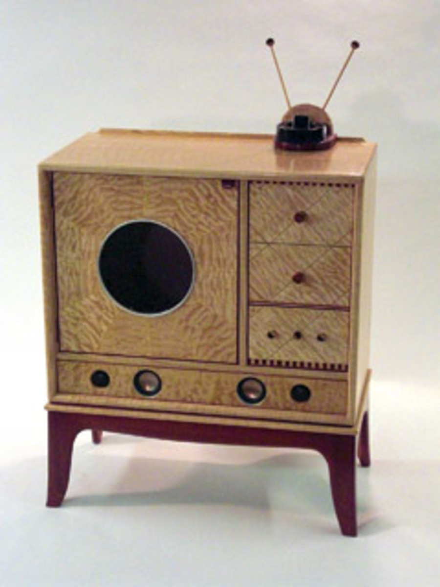 """The """"Jukebox Liquor Cabinet,"""" designed to look like a TV, is made of curly red oak, quilted maple, paduak, purpleheart and silverleaf."""