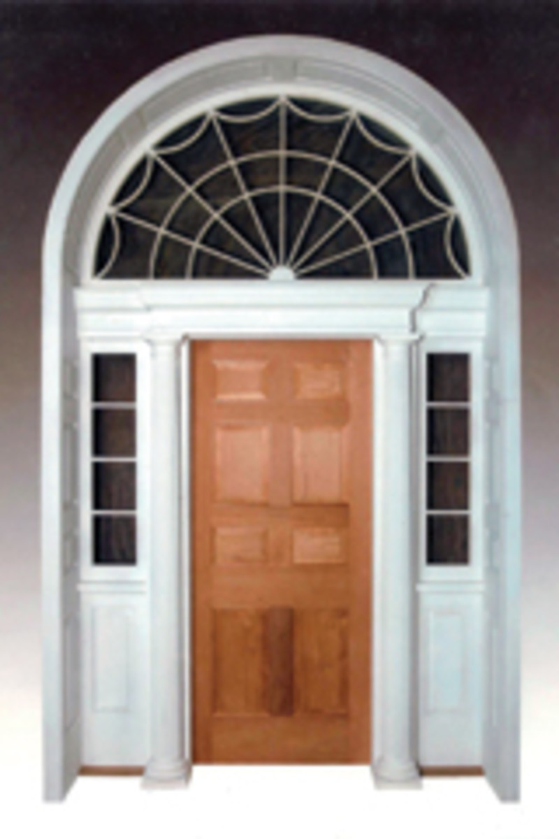 This reproduction of a classical stone house entryway includes a large fan, light transom and side lights. It has curved reflection paneling for a deep wall and Doric columns with attic bases.