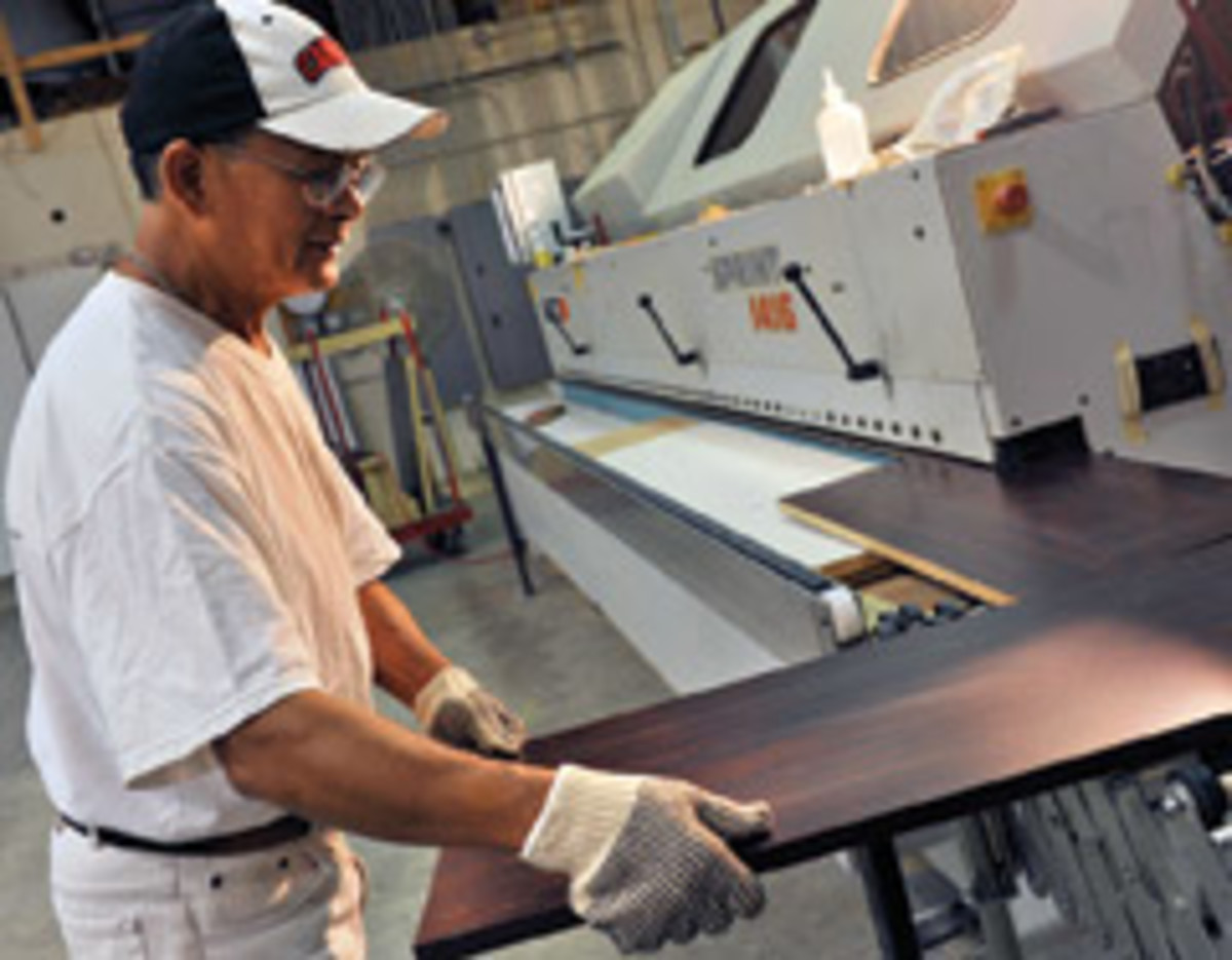 Ly Minh operates the shop's Holz-Her edgebander.
