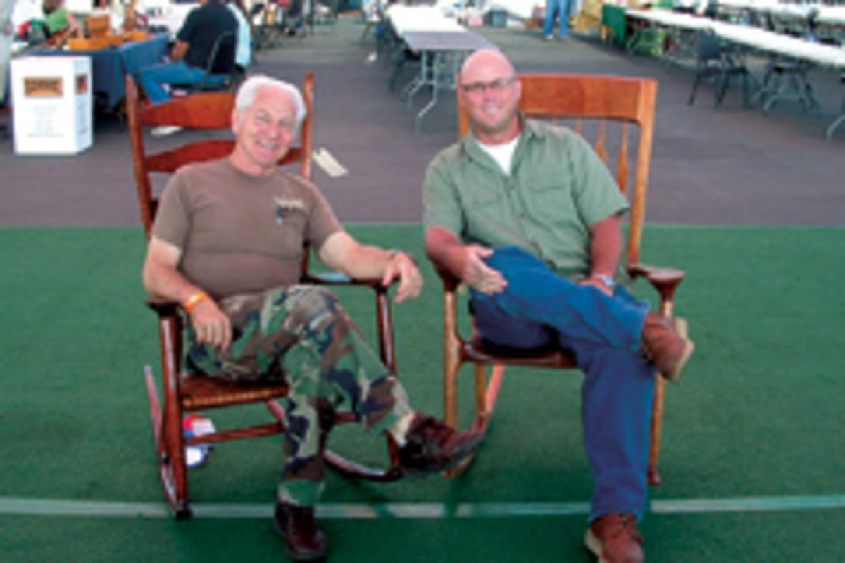 John Morris (right) with fellow furniture maker Russ Filbeck. Morris oversees the website that raises awareness about disabled veterans throughout the U.S.