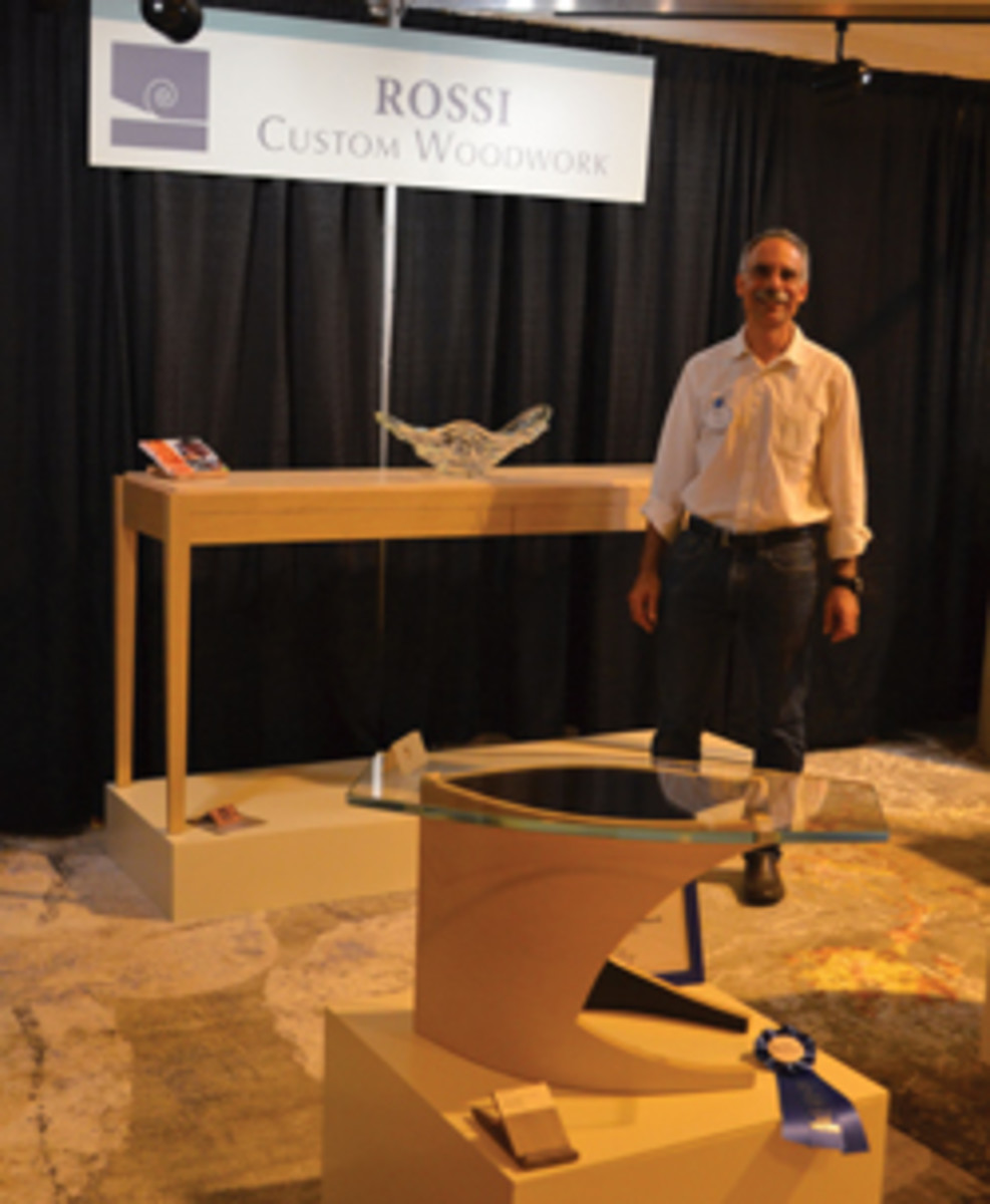 Fred Rossi in his booth at the Fine Furnishings Show.