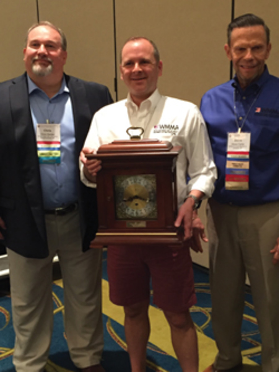 Jamison Scott receives the 2017 Ralph P. Baldwin award from WMMA president Chris Hacker (left) and vice president Steve Carter.