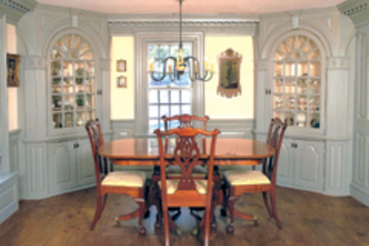 Maurer & Shepherd Joyners built this reproduction of a late 18th century interior with a five-step cornice, cockleshell corner cupboards and two-tone paneling.