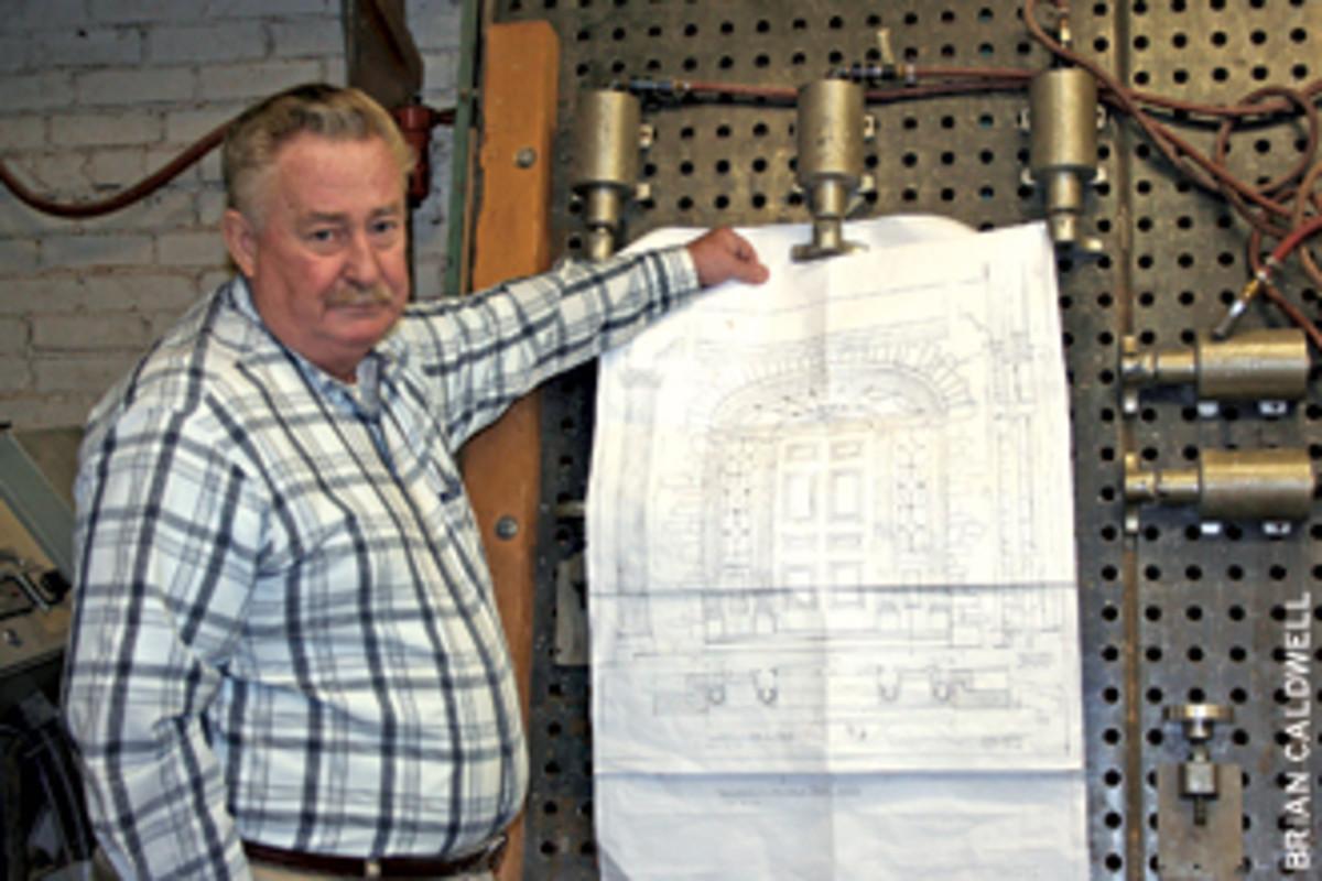 Hap Shepherd, owner of Maurer & Shepherd Joyners in Glastonbury, Conn., displays and architect's view of an entryway for a mansion in the Oyster Bay section of Long Island, N.Y.