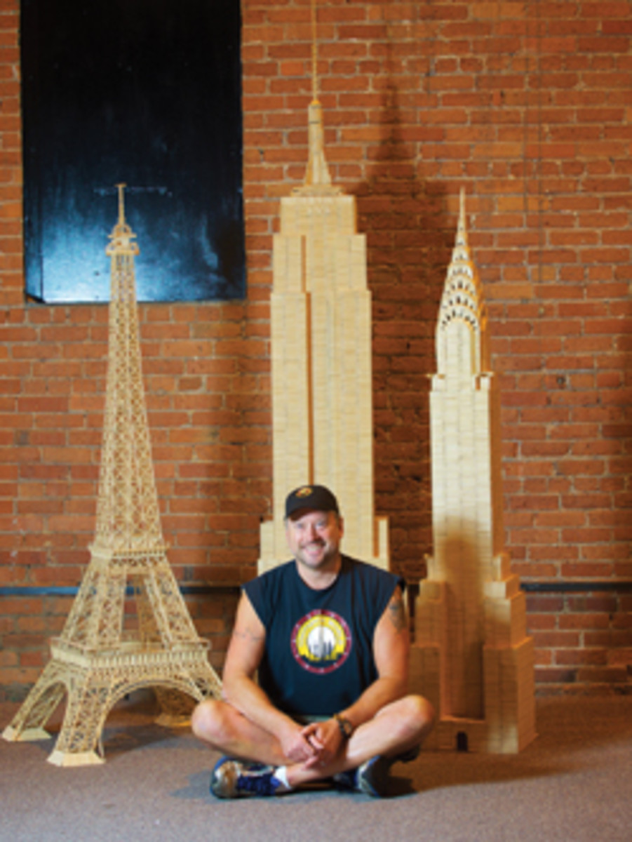 Stan Munro with his Empire State Building, Chrysler Building and Eiffel Tower toothpick replicas.