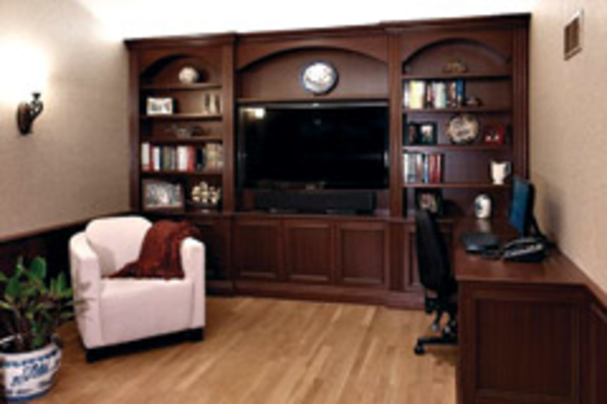 Studio L also builds traditional wall units. This project features sapelle and full-depth arches.