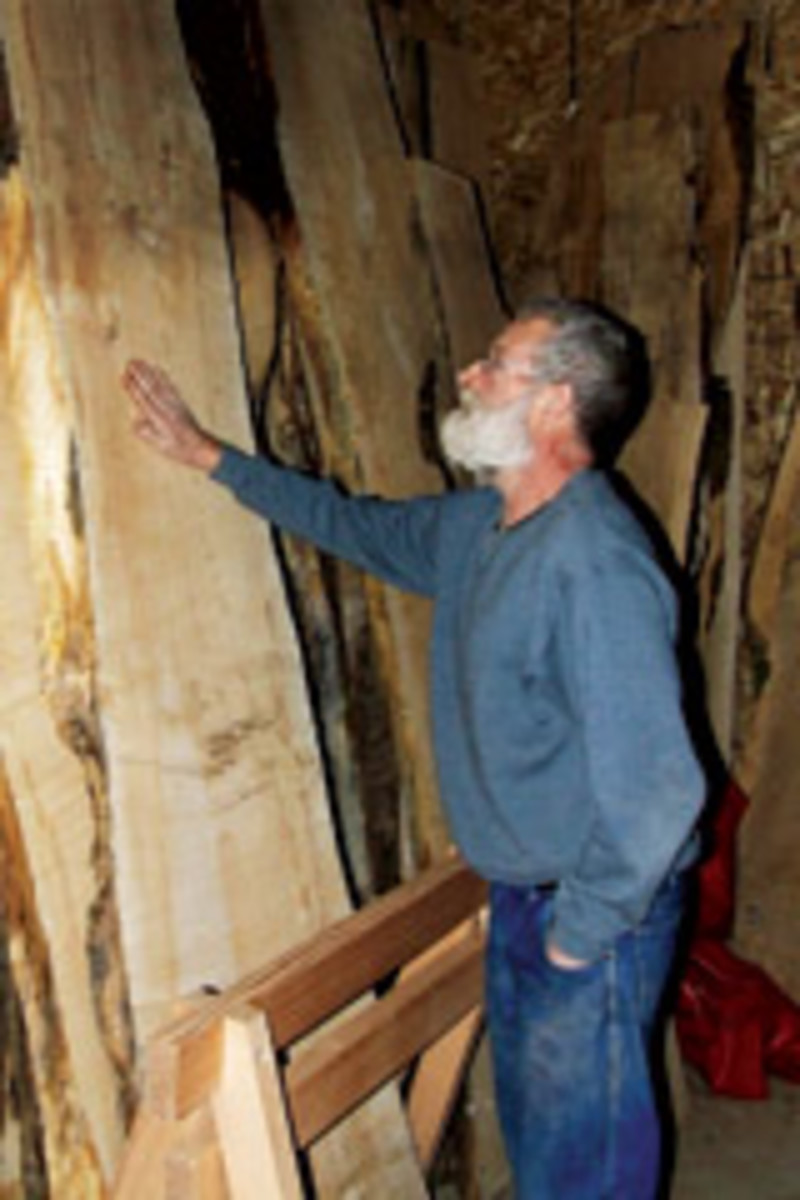 Holz examines some of his slabs, deciding what should be made from them. He maintains an inventory of nearly 2,000 slabs and says the character of each determines what should be created from that particular slab.