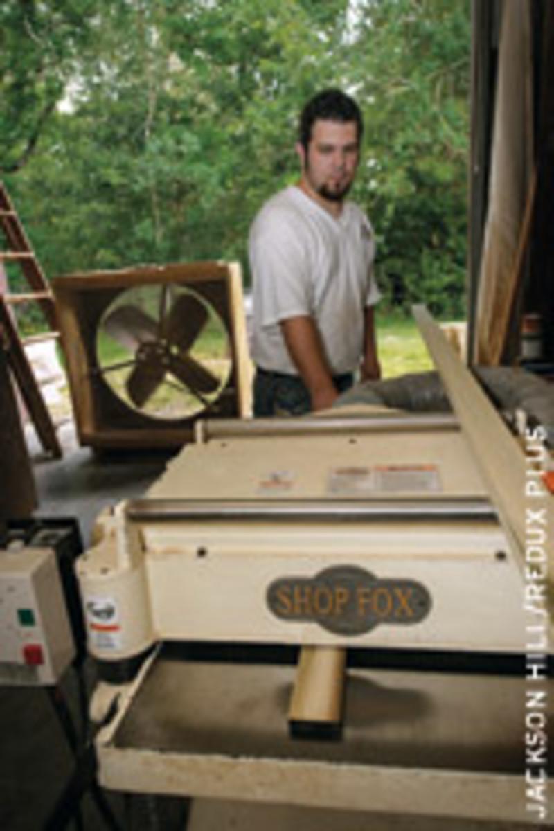 Terry Glaub operates the shop's Shop Fox planer.