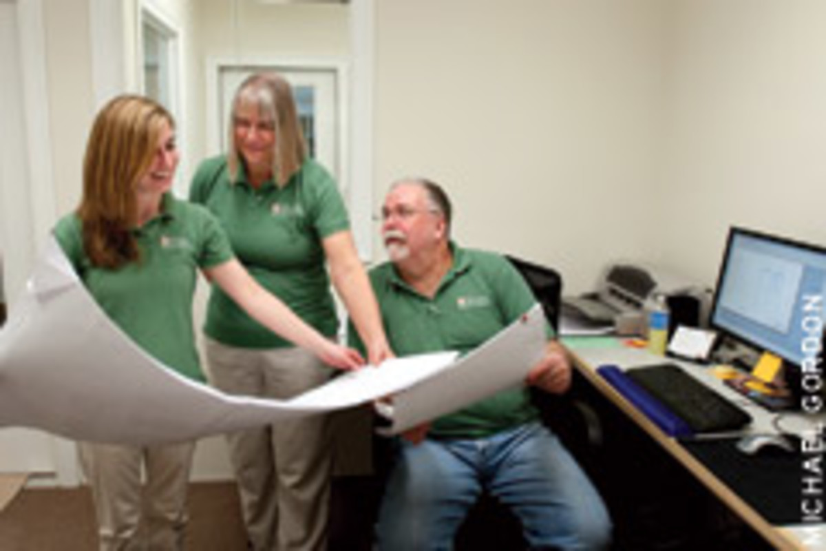 Estimator Liz Robbins, left, with the co-owners of Shaw Woodworking.