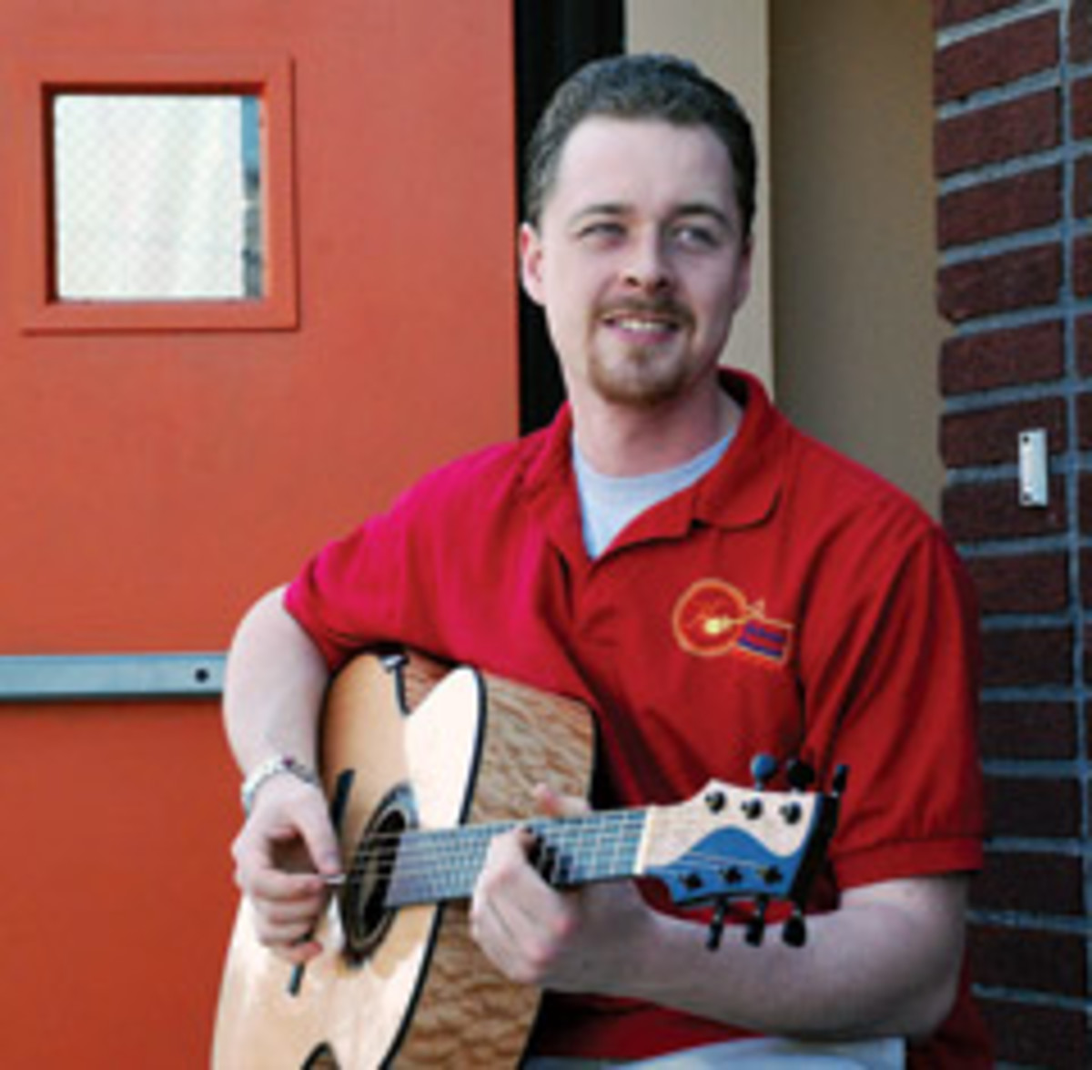Ian Kelly specializes in creating hand-built custom acoustic and electric guitars. He says his formal training is what separates his product from commercial retailers.