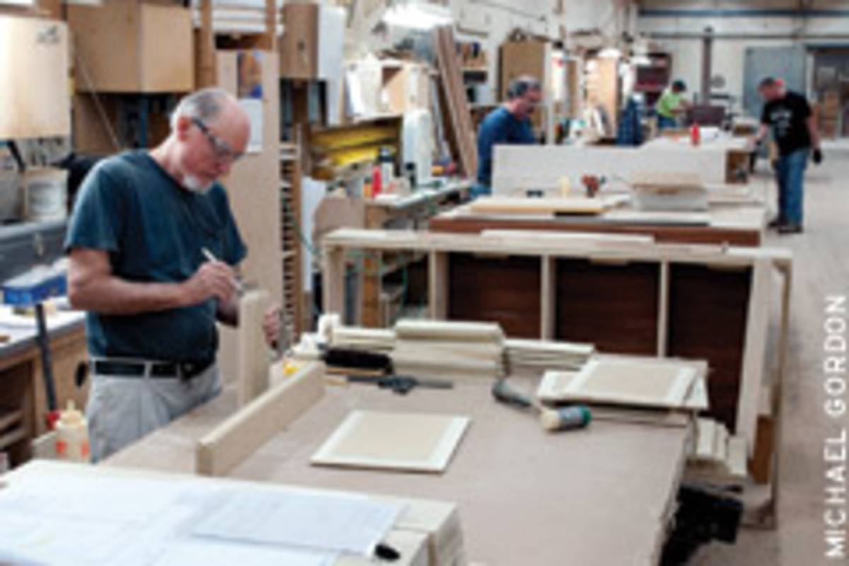 Ken Blake, who's been with Windham Millwork for 32 years, assembles cabinet doors.
