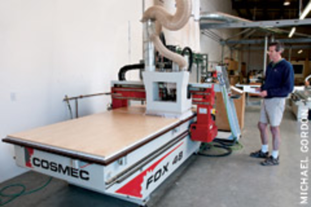 Shop foreman Chris Davis operates the shop's Holz-Her Cosmec Fox 48 CNC router.
