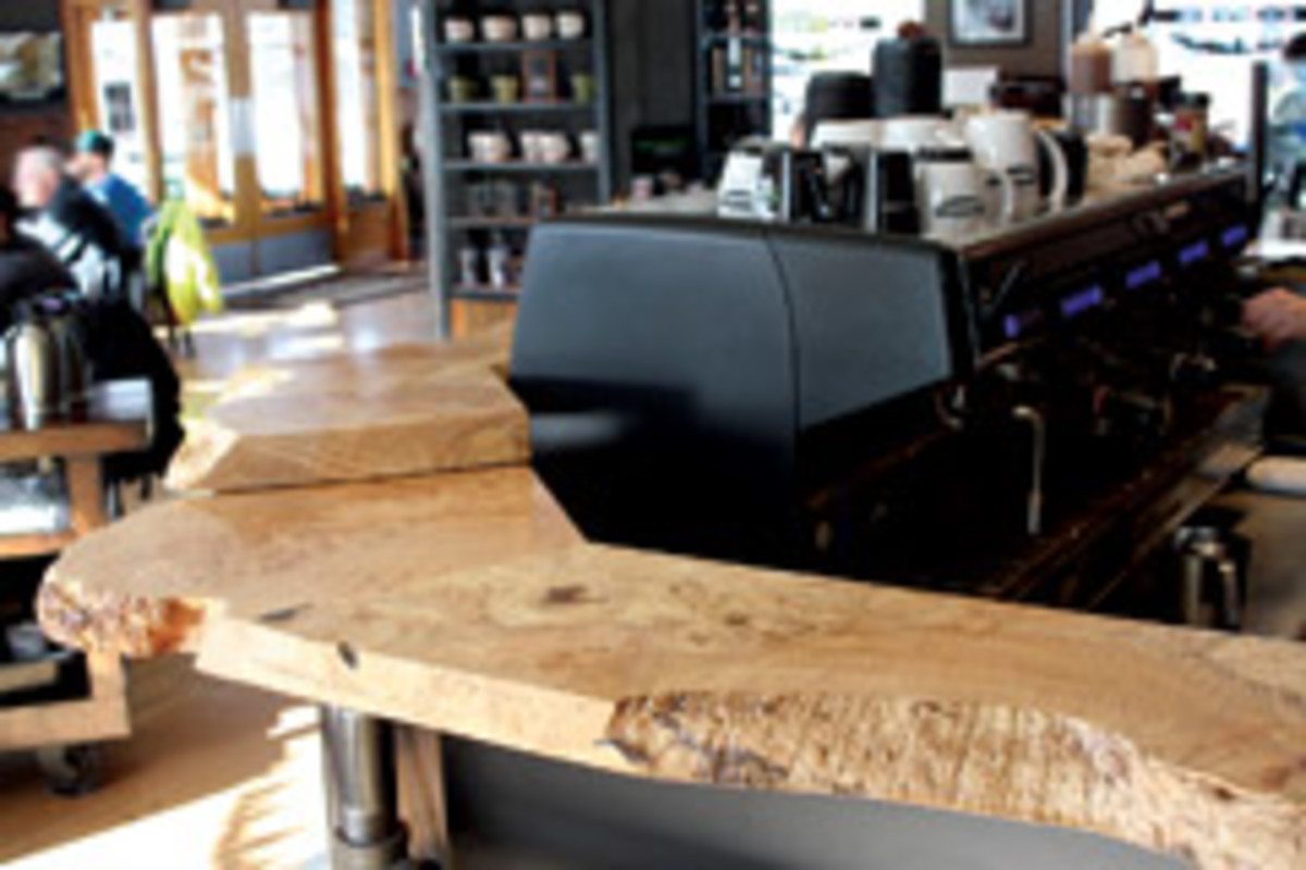 The Woods Coffee stores feature tables, bars and counter surfaces created by Holz.