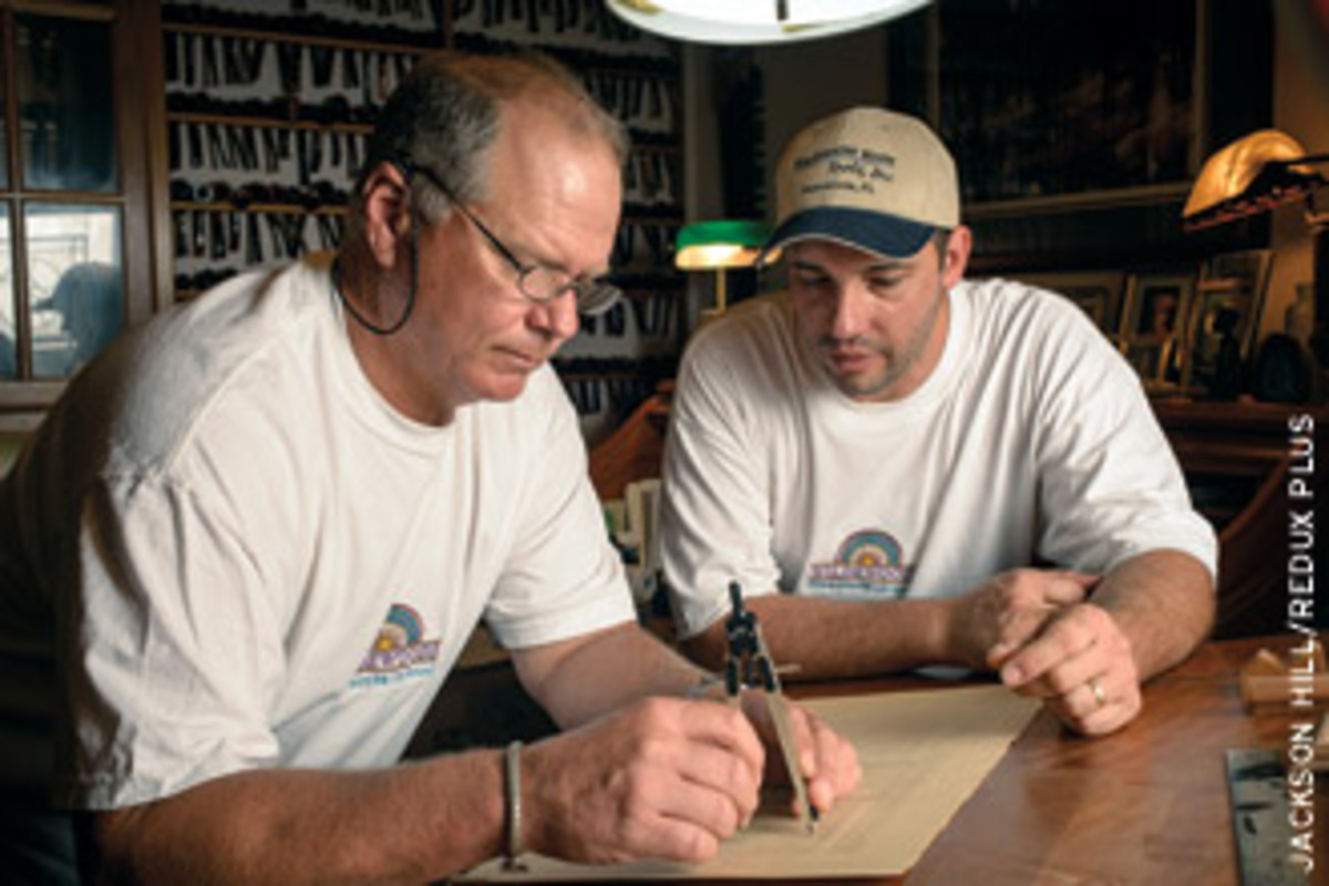 Terry Wilde, left, and employee Chad Jennings work on a design.