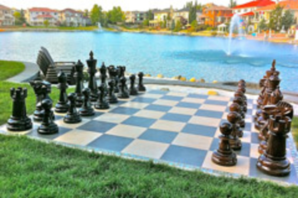 GiantChess.com makes large chess pieces from teak and stone boards for outdoor installations.