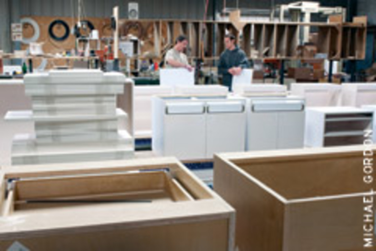 Employees Mike Turcotte, left, and Zach Shreves in one of the cabinet assembly areas.