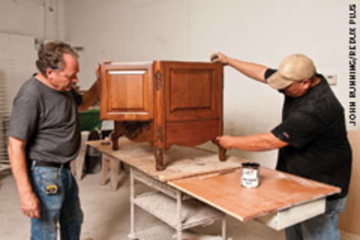 Clark, with employee Melvin Monroe (right), started Distinctive Woodworks while working in another cabinet shop.
