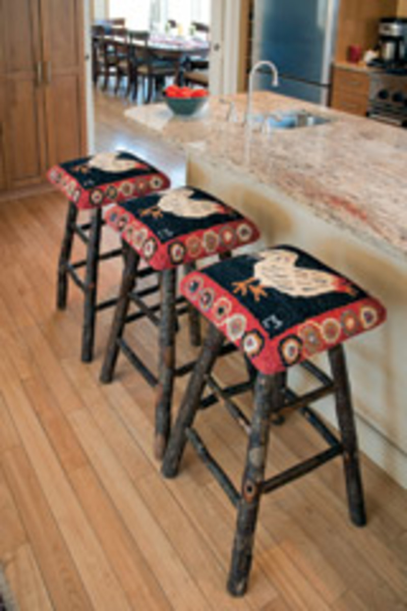 Rooster stools feature a combination of Old World Amish woodworking with hand-hooking upholstery skills from India.
