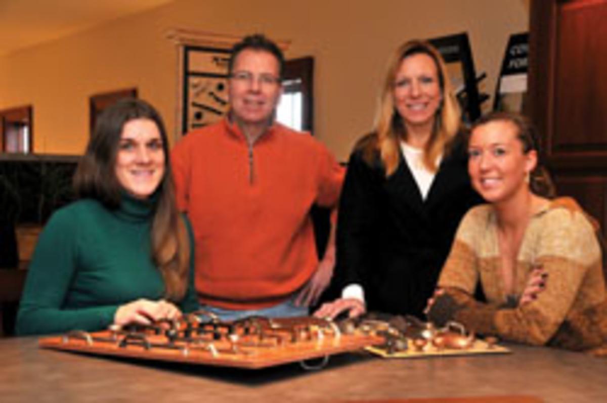 From left is office manager Amy Flynn, owner Richard Doyle, designer Amy Kruger and junior designer Kristin Krug.