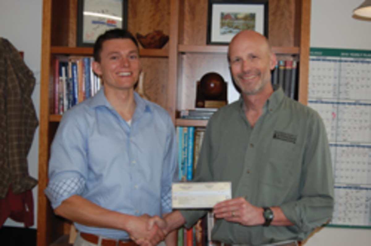 NESAW director Greg Larson (right) with student scholarship winner Jake Cazja.