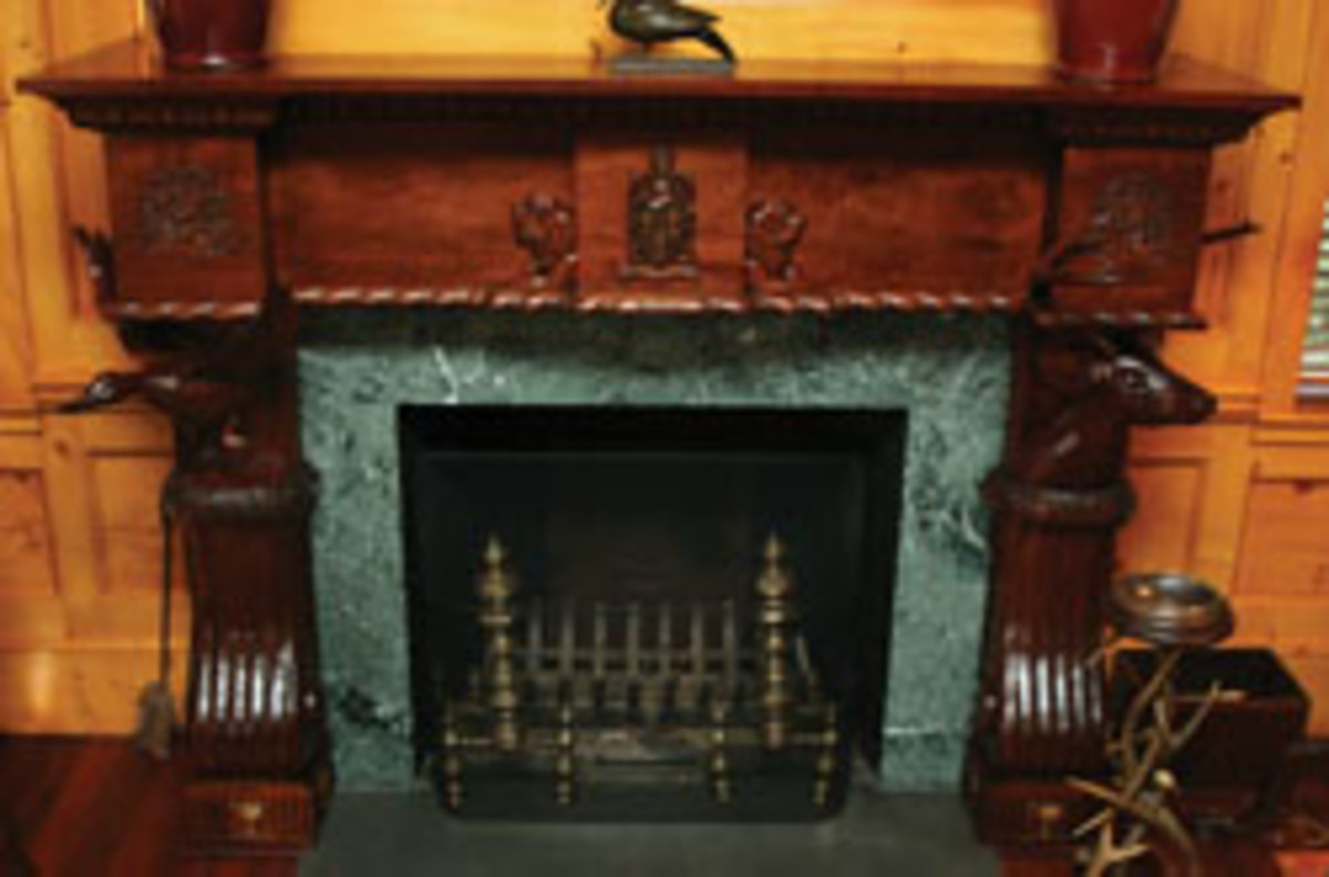 Watts' furniture features hand-rubbed finishes and intricate carvings.