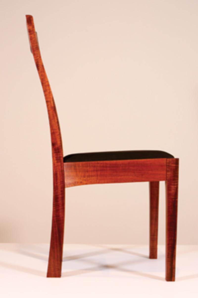 Curator Jamie Schell's koa chair.