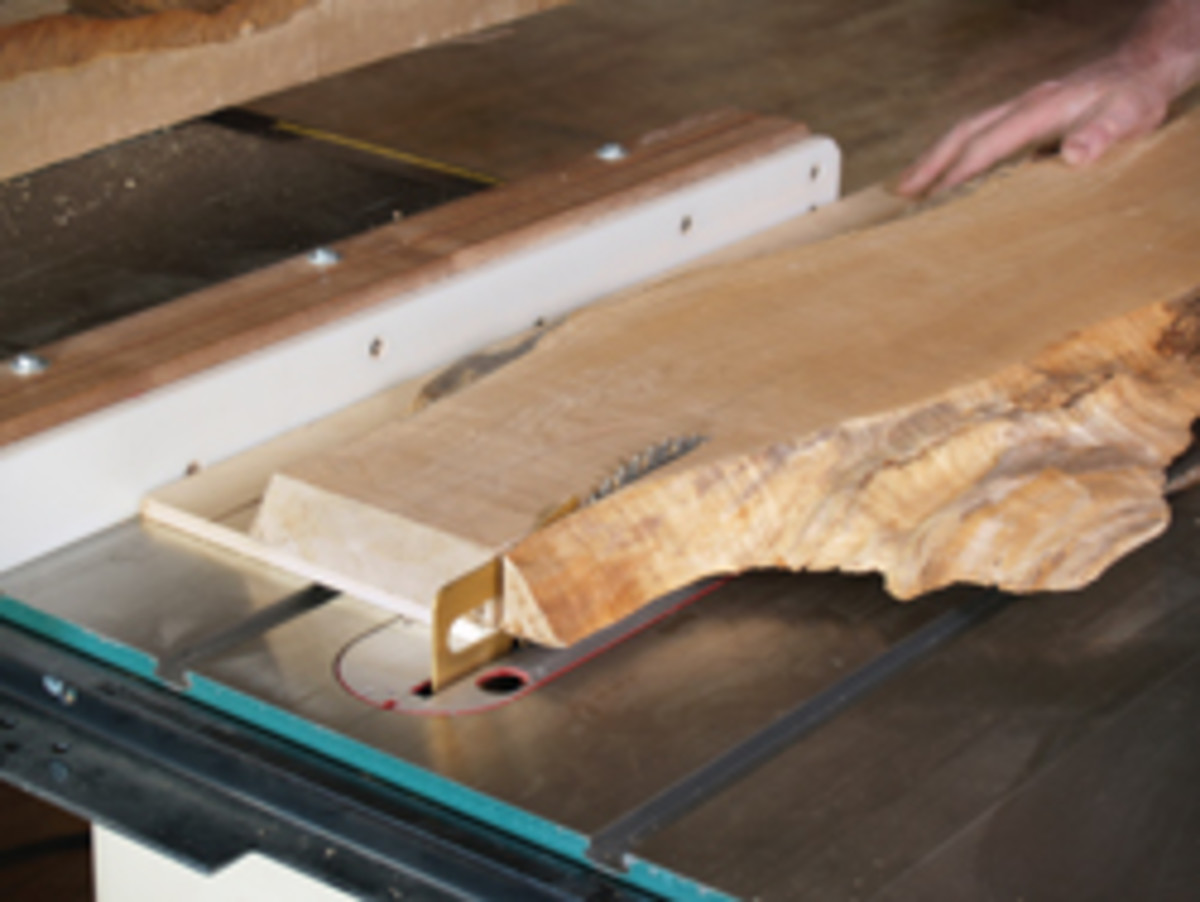 Getting a straight cut without a straight edge is a problem. An easy solution is to attach a plywood base.