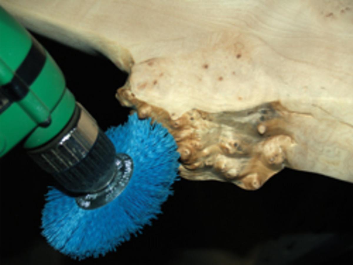 A nylon brush chucked in a corded drill will remove the bark.