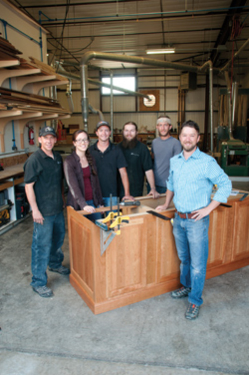 """Dustin Sanders (above, left) has set up shop to produce """"anything out of wood."""""""