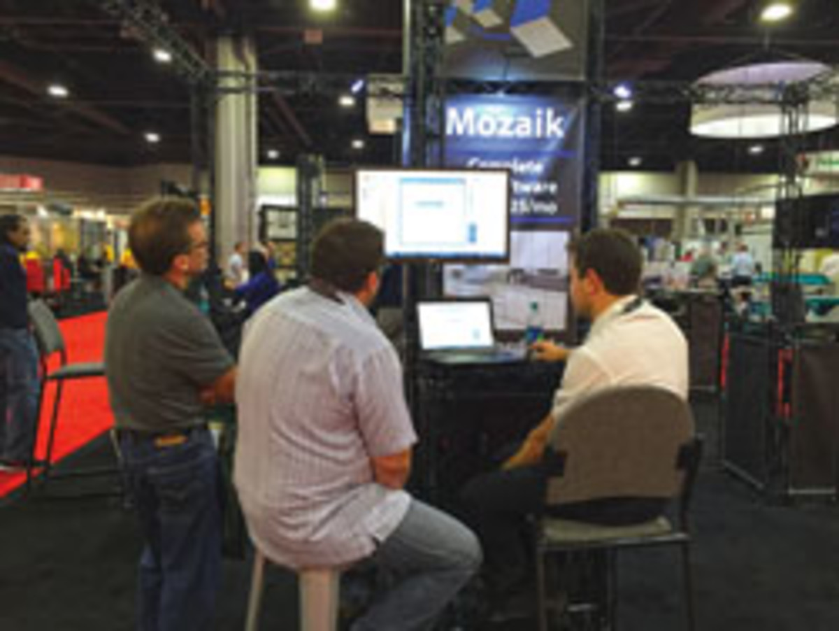 Attendees visit Mozaik Software's booth at IWF 2016.