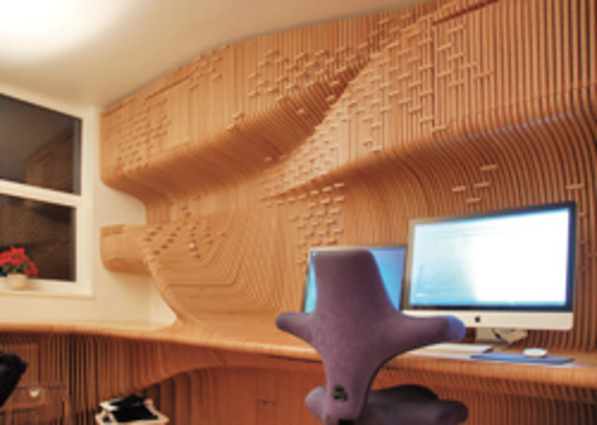 This 12mm birch plywood office, conceived by Synthesis Design and executed by Cutting Edge of Bedfordshire, England, was modeled in Rhino and cut on a 3-axis CNC.
